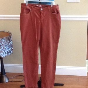 Rust colored skinny jeans